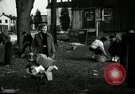 Image of People cleaning up a lot for use as a playground Monroe New York USA, 1950, second 15 stock footage video 65675032772