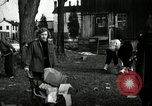 Image of People cleaning up a lot for use as a playground Monroe New York USA, 1950, second 16 stock footage video 65675032772