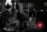 Image of People cleaning up a lot for use as a playground Monroe New York USA, 1950, second 25 stock footage video 65675032772