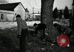 Image of People cleaning up a lot for use as a playground Monroe New York USA, 1950, second 27 stock footage video 65675032772