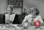 Image of American family preparing Thanksgiving dinner United States USA, 1954, second 57 stock footage video 65675032785