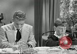 Image of American family preparing Thanksgiving dinner United States USA, 1954, second 59 stock footage video 65675032785