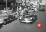 Image of New York City police car driving in midtown Manhattan New York City USA, 1939, second 2 stock footage video 65675032802