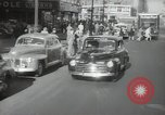 Image of New York City police car driving in midtown Manhattan New York City USA, 1939, second 3 stock footage video 65675032802