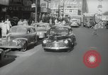 Image of New York City police car driving in midtown Manhattan New York City USA, 1939, second 6 stock footage video 65675032802