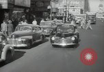 Image of New York City police car driving in midtown Manhattan New York City USA, 1939, second 9 stock footage video 65675032802