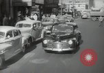 Image of New York City police car driving in midtown Manhattan New York City USA, 1939, second 13 stock footage video 65675032802