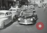 Image of New York City police car driving in midtown Manhattan New York City USA, 1939, second 14 stock footage video 65675032802