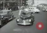 Image of New York City police car driving in midtown Manhattan New York City USA, 1939, second 16 stock footage video 65675032802