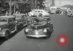 Image of New York City police car driving in midtown Manhattan New York City USA, 1939, second 17 stock footage video 65675032802