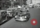 Image of New York City police car driving in midtown Manhattan New York City USA, 1939, second 18 stock footage video 65675032802