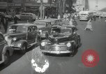 Image of New York City police car driving in midtown Manhattan New York City USA, 1939, second 19 stock footage video 65675032802