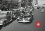 Image of New York City police car driving in midtown Manhattan New York City USA, 1939, second 20 stock footage video 65675032802