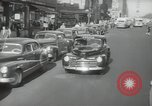 Image of New York City police car driving in midtown Manhattan New York City USA, 1939, second 25 stock footage video 65675032802