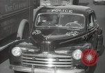 Image of New York City police car driving in midtown Manhattan New York City USA, 1939, second 29 stock footage video 65675032802
