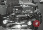Image of New York City police car driving in midtown Manhattan New York City USA, 1939, second 30 stock footage video 65675032802