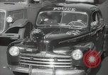 Image of New York City police car driving in midtown Manhattan New York City USA, 1939, second 31 stock footage video 65675032802