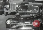 Image of New York City police car driving in midtown Manhattan New York City USA, 1939, second 32 stock footage video 65675032802