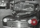 Image of New York City police car driving in midtown Manhattan New York City USA, 1939, second 33 stock footage video 65675032802