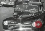 Image of New York City police car driving in midtown Manhattan New York City USA, 1939, second 34 stock footage video 65675032802