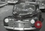 Image of New York City police car driving in midtown Manhattan New York City USA, 1939, second 36 stock footage video 65675032802