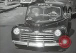 Image of New York City police car driving in midtown Manhattan New York City USA, 1939, second 37 stock footage video 65675032802