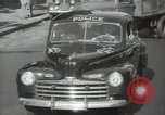 Image of New York City police car driving in midtown Manhattan New York City USA, 1939, second 38 stock footage video 65675032802