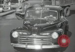 Image of New York City police car driving in midtown Manhattan New York City USA, 1939, second 39 stock footage video 65675032802