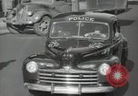 Image of New York City police car driving in midtown Manhattan New York City USA, 1939, second 40 stock footage video 65675032802