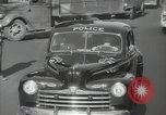 Image of New York City police car driving in midtown Manhattan New York City USA, 1939, second 41 stock footage video 65675032802
