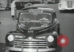 Image of New York City police car driving in midtown Manhattan New York City USA, 1939, second 43 stock footage video 65675032802