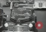 Image of New York City police car driving in midtown Manhattan New York City USA, 1939, second 44 stock footage video 65675032802