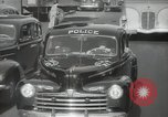Image of New York City police car driving in midtown Manhattan New York City USA, 1939, second 45 stock footage video 65675032802