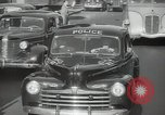 Image of New York City police car driving in midtown Manhattan New York City USA, 1939, second 46 stock footage video 65675032802