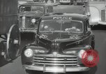 Image of New York City police car driving in midtown Manhattan New York City USA, 1939, second 47 stock footage video 65675032802