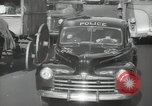 Image of New York City police car driving in midtown Manhattan New York City USA, 1939, second 48 stock footage video 65675032802