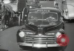 Image of New York City police car driving in midtown Manhattan New York City USA, 1939, second 49 stock footage video 65675032802