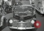 Image of New York City police car driving in midtown Manhattan New York City USA, 1939, second 50 stock footage video 65675032802