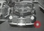 Image of New York City police car driving in midtown Manhattan New York City USA, 1939, second 51 stock footage video 65675032802