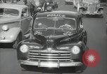 Image of New York City police car driving in midtown Manhattan New York City USA, 1939, second 52 stock footage video 65675032802