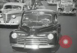 Image of New York City police car driving in midtown Manhattan New York City USA, 1939, second 53 stock footage video 65675032802