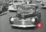 Image of New York City police car driving in midtown Manhattan New York City USA, 1939, second 54 stock footage video 65675032802