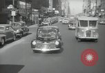 Image of New York City police car driving in midtown Manhattan New York City USA, 1939, second 56 stock footage video 65675032802