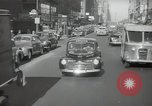 Image of New York City police car driving in midtown Manhattan New York City USA, 1939, second 57 stock footage video 65675032802