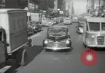 Image of New York City police car driving in midtown Manhattan New York City USA, 1939, second 58 stock footage video 65675032802