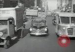 Image of New York City police car driving in midtown Manhattan New York City USA, 1939, second 59 stock footage video 65675032802