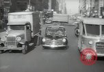 Image of New York City police car driving in midtown Manhattan New York City USA, 1939, second 60 stock footage video 65675032802