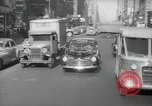 Image of New York City police car driving in midtown Manhattan New York City USA, 1939, second 61 stock footage video 65675032802