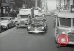 Image of New York City police car driving in midtown Manhattan New York City USA, 1939, second 62 stock footage video 65675032802