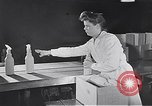 Image of liquor bottle United Kingdom, 1950, second 33 stock footage video 65675032848